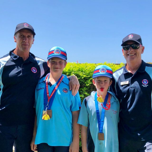 Cooper and Dalton getting medals from Steven Pearce & George Shales
